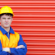 Young worker wearing a hardhat - Stock Photo