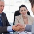 Smiling business team concluding an agreement with a client — Stock Photo