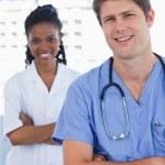 Portrait of happy doctors standing up — Stock Photo