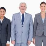 Три улыбаясь бизнесменов — Стоковое фото