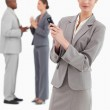 Saleswoman holding cellphone with colleagues behind her — Stock Photo #10322210