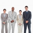 Smiling young businessteam standing together — Stock Photo #10322513