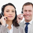 Royalty-Free Stock Photo: Call center team with their headsets