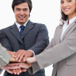 Stock Photo: Young businessteam putting hands together