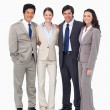 Smiling young salespeople standing together — Stock Photo