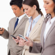 Group of businesspeople with their cellphones — Stock Photo