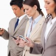 Group of businesspeople with their cellphones — Stock Photo #10323070