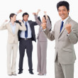 Stock Photo: Successful businessmwith cheering team