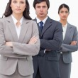 Serious salesteam standing together with arms folded — Stock Photo
