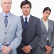 Mature businessman standing with his employees — Stock Photo