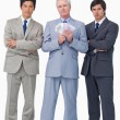 Senior salesman with money and his employees — Stock Photo