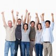 Smiling group of friends giving thumbs up — Stock Photo