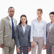 Serious business team side by side — Stock Photo