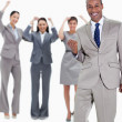 Stockfoto: Successful business team with happy businessmin foreground