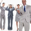 图库照片: Successful business team with happy businessmin foreground