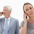 Close-up of a woman on the phone with a white hair businessman — Stock Photo
