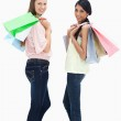 Smiling girls with a lot of shopping bags against white background — Stock Photo #10324219