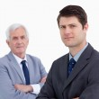 Close up of young businessman with his mentor behind him — Stock Photo #10325670