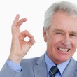 Close up of mature tradesman giving his approval — Stock Photo