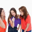 Teenage girls energetically singing in a microphone — Stock Photo