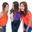 Teenagers laughing while singing karaoke - Stockfoto