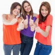 Teenage girls showing their happiness by putting their thumbs up — Stock Photo #10326998