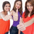 Three teenage girls proudly showing their happiness by putting t — Stock Photo #10327000