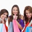 Teenage girls proudly coming back from shopping - Stock Photo