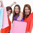Young women elevating their purchase bags - Stock Photo