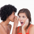 Teenager hearing a surprising secret from her friend — Stock Photo