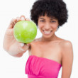 Beautiful green apple held by a young woman — Stock Photo
