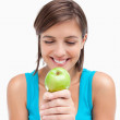 Smiling teenager looking at a green apple placed on her hands cr — Stock Photo #10327254