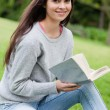Young smiling woman holding her book while looking at the camera — Stock Photo #10328639