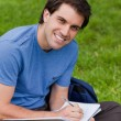 Young man sitting cross-legged while working — Stock Photo #10328726