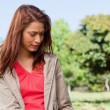 Young woman reading a book in the park — Stock Photo #10328933