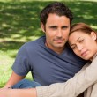 Man with his friend who is resting her head on his shoulder - Stock Photo