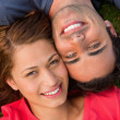 Close-up of two friends looking upwards while lying head to shou — Stock Photo #10329148