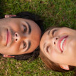 Close-up of two friends looking at each other while lying head t — Stock Photo #10329177