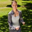 Stock Photo: Woman smiling while jogging