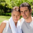 Woman and a man standing together in workout gear — Stock Photo