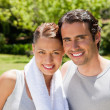 Woman with and man smiling in workout gear — Stock Photo #10329285