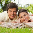 Stock Photo: Two friends lying together on a blanket while smiling