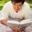 Mreading book while he lies on blanket — Stock Photo #10329487