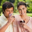 Stock Photo: Womsmiling while her friend is drinking wine