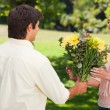 Royalty-Free Stock Photo: Man presents his friend with flowers
