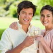 Stock Photo: Two friends smiling while touching glasses of champagne