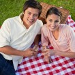 Two friends looking upwards during a picnic — Stock Photo