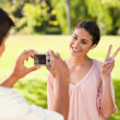 Man takes a photo of his friend giving the peace sign — Stock Photo #10329805