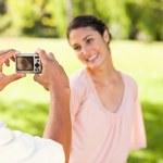 Man takes a photo of his smilng friend — Stock Photo #10329808