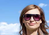 Caucasian woman is wearing glasses outdoor — Stock Photo